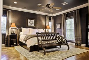 Contemporary Guest Bedroom with Glass panel door, Ceiling fan, Hardwood floors, Crown molding, Carpet