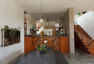 Asian Dining Room with Standard height, complex marble floors, Pendant light, Built-in bookshelf
