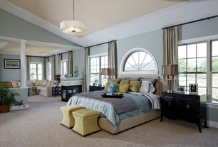 Traditional Master Bedroom with Columns, Skyline Nail Button Storage Ottoman, High ceiling, Arched window, Built-in bookshelf