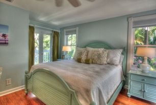 Cottage Guest Bedroom with Hardwood floors, Ceiling fan, French doors