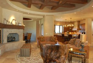 Mediterranean Great Room with limestone floors, Cement fireplace, Chandelier, Exposed beam