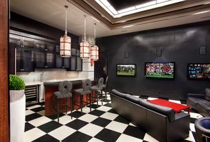 Contemporary Man Cave with Concrete tile , Pendant light, Built-in bookshelf, Standard height, can lights
