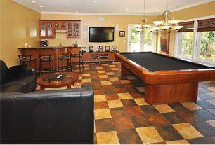 Eclectic Game Room with French doors, Standard height, Chandelier, Built-in bookshelf, stone tile floors, slate tile floors