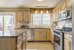 Traditional Kitchen with Undermount sink, L-shaped, flush light, Balcony, Complex granite counters, Raised panel