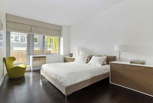 Contemporary Master Bedroom with French doors, Hardwood floors