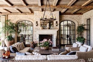 Country Living Room with French doors, Restoration hardware pillar candle sconce, Illumination Steel Arched French Door