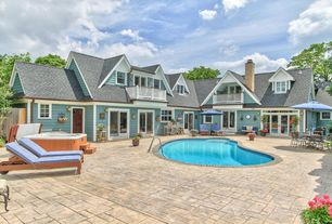 Country Swimming Pool with exterior tile floors, Fence, Transom window, French doors