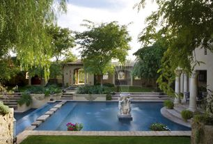 Mediterranean Landscape/Yard with exterior stone floors, Pathway, Pond, Fountain