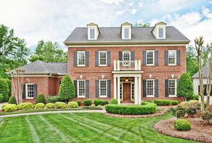 Traditional Exterior of Home with Brick exterior, Exterior window shutters