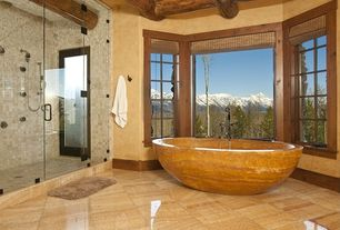 Rustic Master Bathroom with Peidra Orion Oval Stone Freestanding Bath Tub, frameless showerdoor, Handheld showerhead