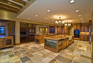 Traditional Kitchen with Farmhouse sink, Exposed beam, U-shaped, Chandelier, Simple granite counters, Kitchen island, Slate