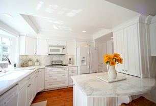 Cottage Kitchen with Casement, Flat panel cabinets, full backsplash, Crown molding, Complex Marble, electric cooktop
