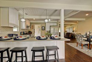 Contemporary Kitchen with Exposed beam, Standard height, Hardwood floors, Pendant light, Columns, Built-in bookshelf