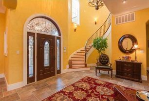 Traditional Entryway with Crown molding, specialty window, Chandelier, High ceiling, Glass panel door, Concrete tile