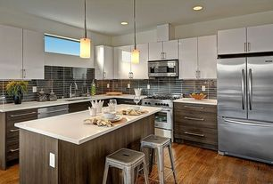 Modern Kitchen with Destiny: slab cabinets, Undermount sink, Corian- Designer White, Frosted glass cylinder mini pendant