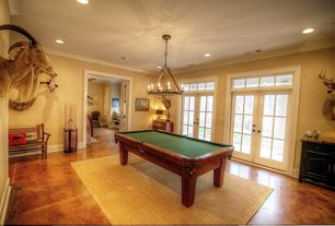 Country Game Room with Chandelier, Crown molding, Concrete floors, Standard height, can lights, Transom window, French doors
