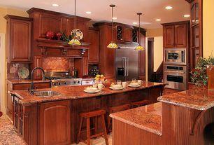 Craftsman Kitchen with limestone tile floors, Limestone Tile, U-shaped, Breakfast bar, Custom hood, Undermount sink