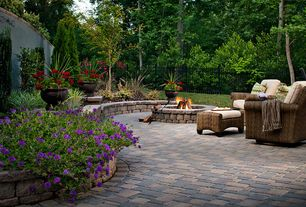 Traditional Patio with Fire pit, exterior stone floors, Raised beds, Fence