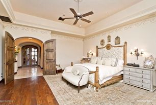 Traditional Master Bedroom with French doors, Hardwood floors, Ceiling fan, Mural, Wall sconce, Crown molding