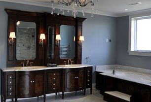 Traditional Master Bathroom with Crown molding, Wall sconce, drop in bathtub, Inset cabinets, Flat panel cabinets, can lights