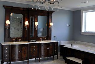 Traditional Master Bathroom with Inset cabinets, Handheld showerhead, Crown molding, Chandelier, frameless showerdoor
