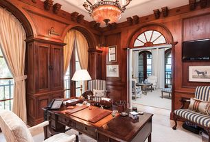 Traditional Home Office with Chandelier, Crown molding, sandstone floors, Wall sconce, French doors, Arched window