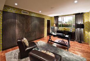 Contemporary Home Office with Standard height, Built-in bookshelf, can lights, interior wallpaper, Hardwood floors, flat door