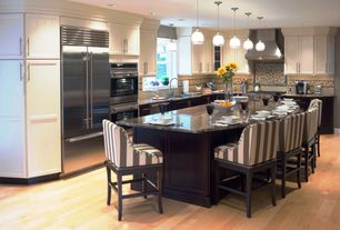 Contemporary Kitchen with Glass panel, Flush, Pendant light, Complex granite counters, Breakfast bar, Flat panel cabinets