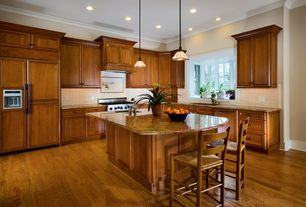 Traditional Kitchen with Raised panel, Custom hood, Subway Tile, Undermount sink, Crown molding, Bay window, Pendant light