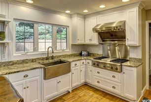 Traditional Kitchen with electric cooktop, Flat panel cabinets, Casement, can lights, Farmhouse sink, full backsplash, Paint