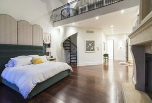 Contemporary Master Bedroom with Modshop delano panel bed, stone fireplace, Cathedral ceiling, Hardwood floors, Loft