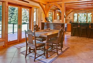 Rustic Dining Room with Standard height, specialty window, French doors, terracotta tile floors, Exposed beam, Pendant light
