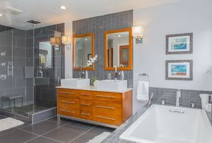 Contemporary Master Bathroom with Corian counters, Wall sconce, Stone Tile, Vessel sink, flush light, European Cabinets