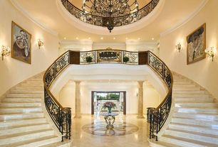 Traditional Staircase with sandstone floors, Chandelier, Double staircase, Wall sconce, Crown molding, High ceiling