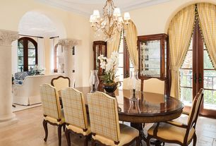 Mediterranean Dining Room with Crown molding, French doors, Chandelier, Columns, limestone floors