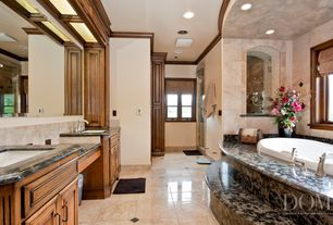 Mediterranean Master Bathroom with Kohler Verticyl Sink, Casement, Shower, Sandstone Tile, Stone Tile, Flat panel cabinets