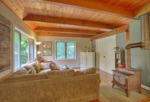 Rustic Living Room with Crown molding, KitchenAid 'Empire' Red 2-quart Tea Kettle, Laminate floors, French doors