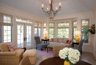 Traditional Living Room with Hardwood floors, Casement, Chandelier, French doors, Crown molding, High ceiling