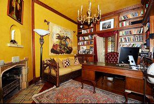 Mediterranean Home Office with Chandelier, stone fireplace, Built-in bookshelf, Crown molding, Hardwood floors
