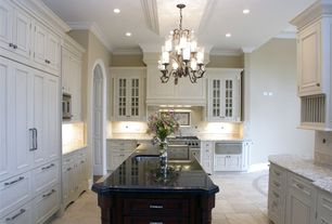 Traditional Kitchen with Ms international black antique granite, Limestone Tile, Raised panel, Chandelier, Undermount sink
