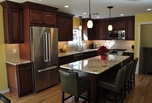 Traditional Kitchen with L-shaped, Complex granite counters, Undermount sink, Pendant light, Kitchen island, Raised panel