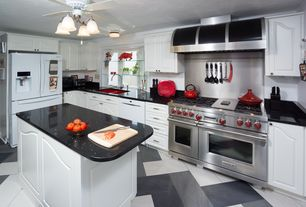 Eclectic Kitchen with L-shaped, Stainless Steel, Raised panel, complex granite tile floors, Ceiling fan, flush light, Flush