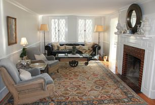 Traditional Living Room with Crown molding, Hardwood floors, Chair rail