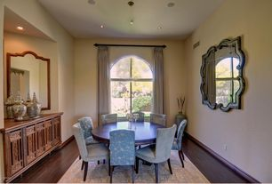 Mediterranean Dining Room with Built-in bookshelf, Hardwood floors, Arched window