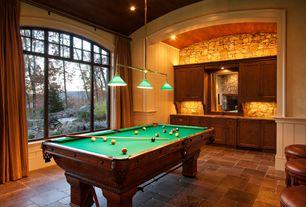 Country Game Room with travertine tile floors, Exposed beam, Built-in bookshelf, Pendant light