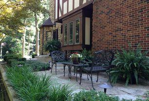 Craftsman Patio with Casement, exterior stone floors, Pathway