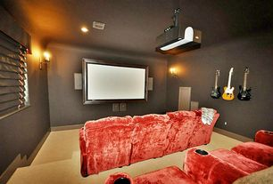 Eclectic Home Theater with Wall sconce, Carpet, interior wallpaper