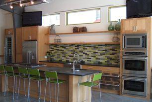 Contemporary Kitchen with Montauk black honed slate tile, Breakfast bar, Limestone Tile, Wine refrigerator, Flush, One-wall