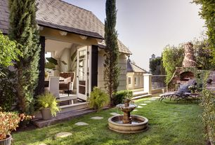 Traditional Landscape/Yard with Fence, exterior stone floors, outdoor pizza oven, French doors, Pathway, Fountain