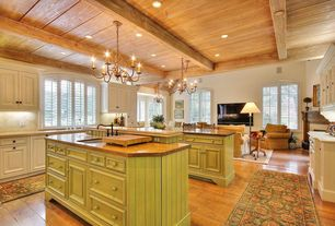 Country Kitchen with Standard height, Limestone counters, Glass panel, Undermount sink, Simple granite counters, U-shaped